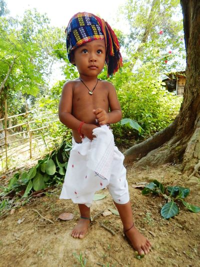 Cultural Of Tripura,North-East India Culture Of Tripura Jamatia Community Culture And Tradition Jamatia Cultural Dress Jamatia Kid In Culturaldress Cute♡ @Maman Jamatia Real People Childhood Outdoors Kids Being Kids Kidsphotography Happiness Smiling Religion Religious Images Rear View Full Length One Person Cute Baby Lifestyles Standing Looking At Camera Tree Day Growth Nature Portrait