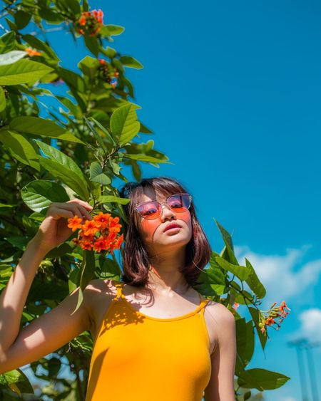 lemonade please One Woman Only Beauty Portrait Summer Tree Blue Day Beauty In Nature Nature Women Around The World Outdoors Beautiful People Light Collection Light_Collection Portrait Of A Woman Plant Flower Flower Collection Tinted Glass Tinted Sunglasses Sunglasses Red Only Women