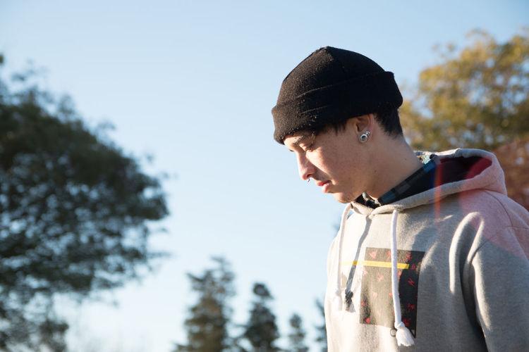 Portrait of boy looking away against sky