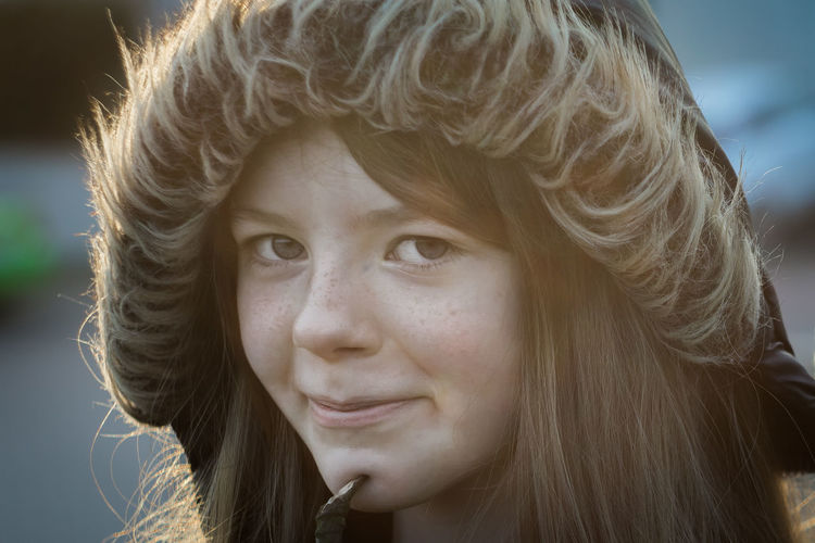 Close-up portrait of girl wearing hooded jacket