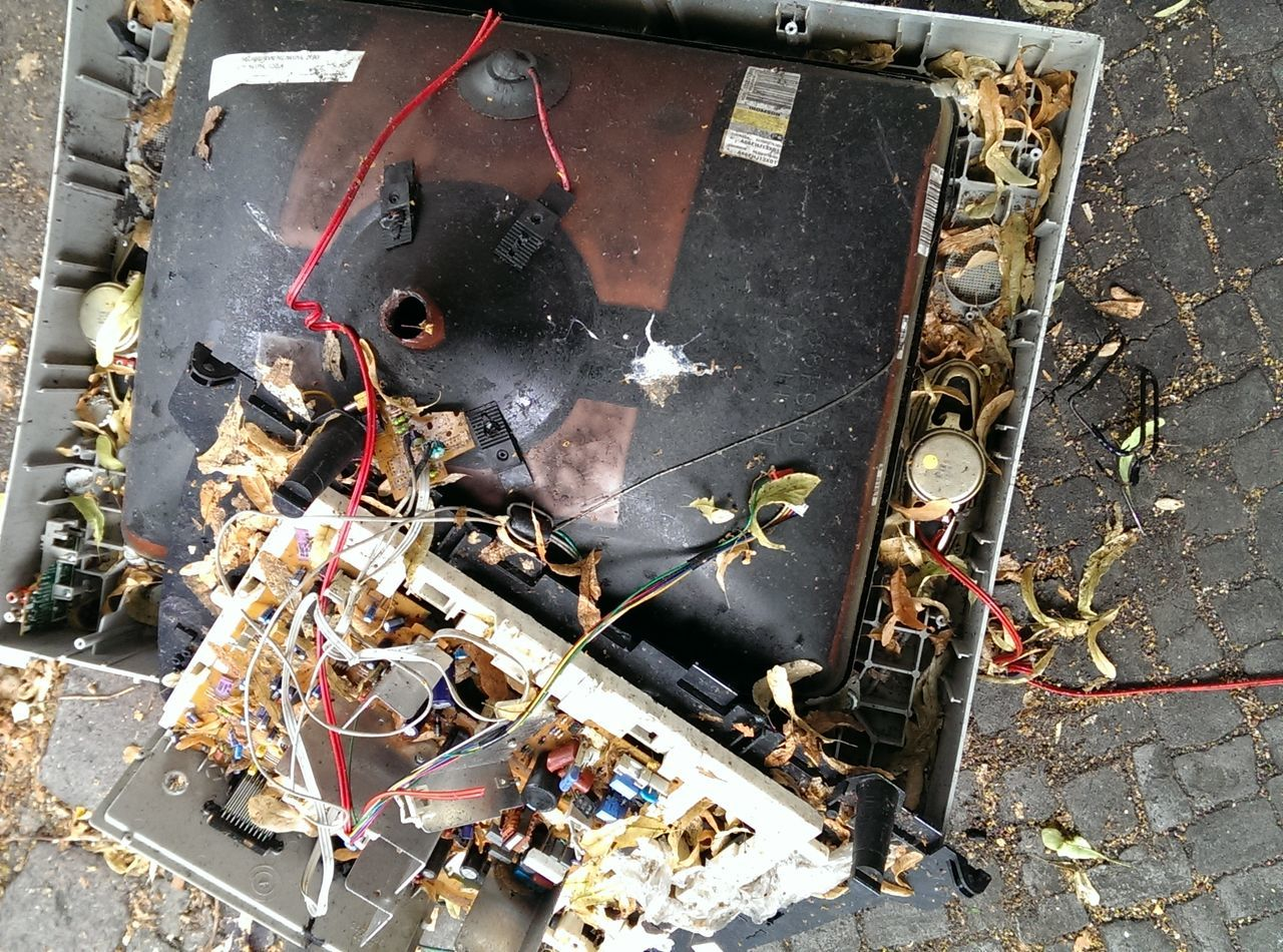 HIGH ANGLE VIEW OF DAMAGED GARBAGE ON STREET