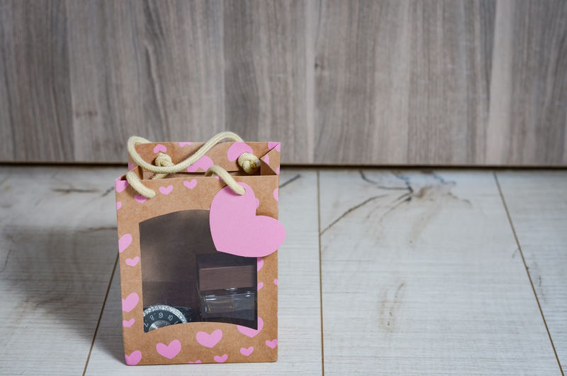 Close-up of pink heart shape on table