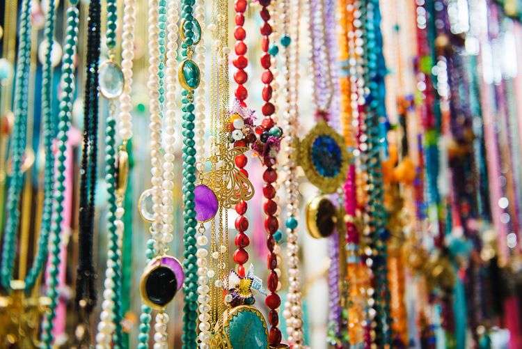Full frame shot of jewelry hanging at market for sale