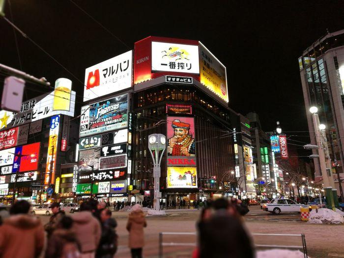 Sapporo,Hokkaido,Japan Susukino Illuminated Large Group Of People Crowded Night City Crowd