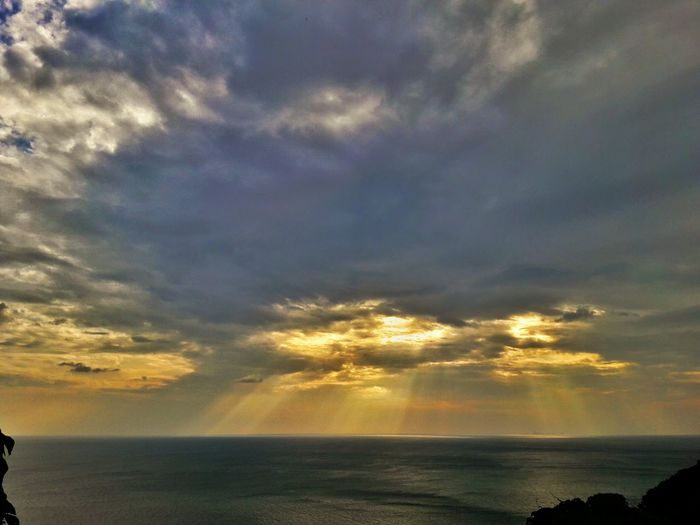 Cloud - Sky Water Dramatic Sky Nature Sea Sky Outdoors Sunset Beach Horizon Over Water Scenics No People Beauty In Nature Tranquility Gold Colored Storm Cloud Day Thunderstorm