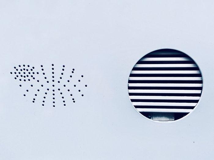 Close-up of intercom against black background