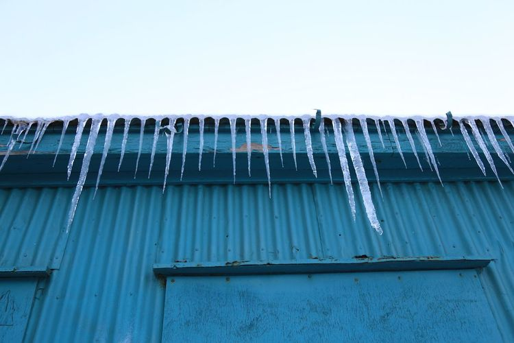 Architecture Building Exterior Built Structure Clear Sky Cold Cold Temperature Corrugated Iron Day Ice Icicle Icicles Low Angle View Nature No People Outdoors Sky Snow Winter