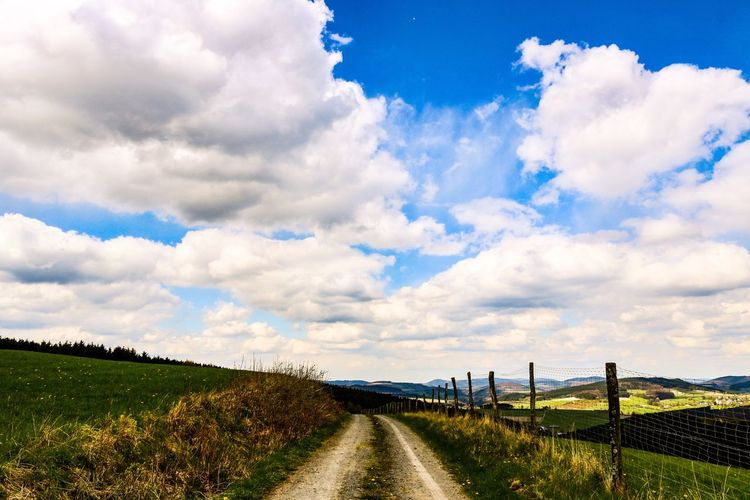 The Way Forward Cloud - Sky Sky Road Tranquil Scene Field Nature Landscape Day Scenics Tranquility Grass No People Outdoors Beauty In Nature Rural Scene Growth The Great Outdoors - 2017 EyeEm Awards