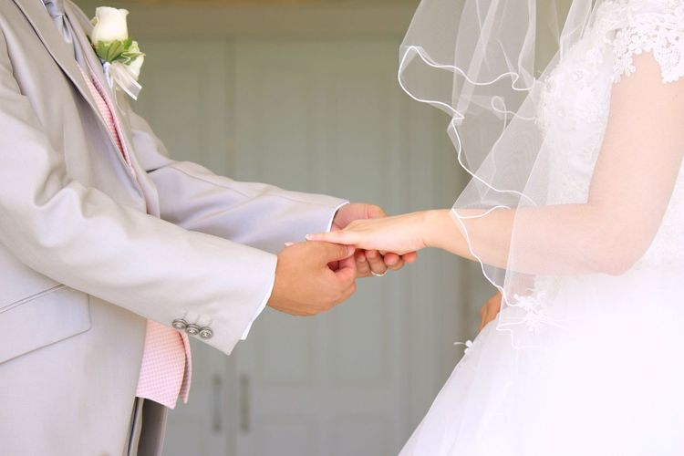 wedding ring Bride Wedding Wedding Dress Life Events Two People Togetherness Love Men Women Celebration Bridegroom Wedding Ceremony Indoors  Real People Well-dressed Close-up Adult Dedication Human Hand Groom