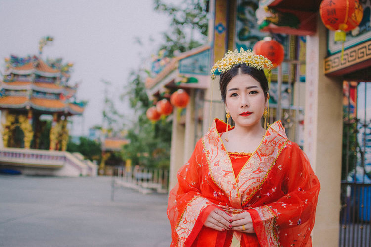 Portrait of woman in traditional clothing standing outdoors