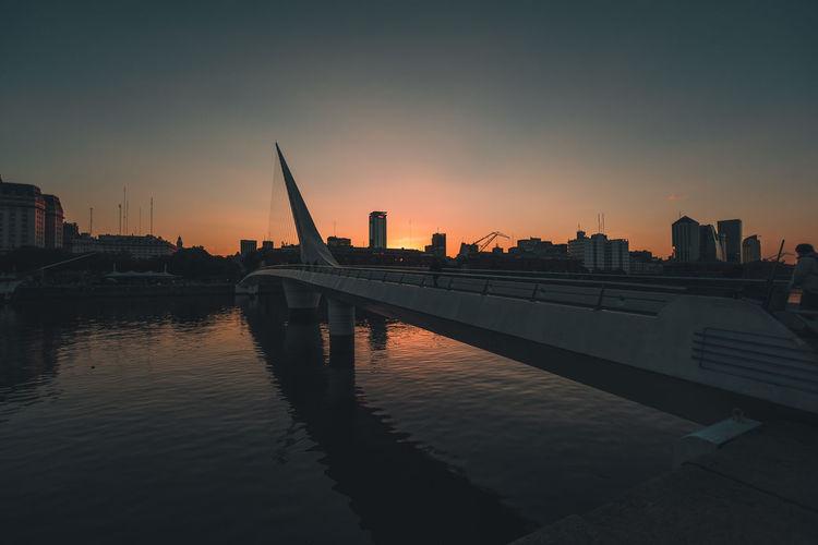Architecture Argentina Bridge City Engineering Lifestyle Orange Color Puente De La Mujer Puerto Madero Sunset Travel Travel Destinations Vacation VSCO Vscocam Water