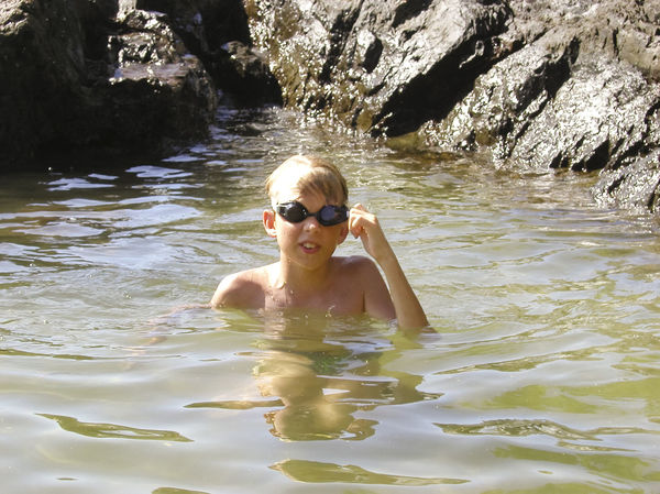 boy with googles in the caribbean sea Blond Hair Boy Caribbean Caribbean Sea Childhood Cliff Diving Equipment Eyeglasses  Googles Happy Head And Shoulders Kid One Boy Only Portrait Rock Sea Shirtless Summer Swimming Swimwear Tobago Vacations Water Wet