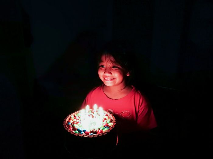 Birthday girl. Happy Birthday Birthday Cake Birthday Party Birthday Candles Birthdaygirl Birthdays Asian Girl Young Girl Celebration Celebration Event darkness and light Happy People Light And Shadow Candlelight Smiling Malay Young People Preschooler Face Light Light Trail Black Background Child Childhood Futuristic Protruding Human Hand Boys Moments Of Happiness