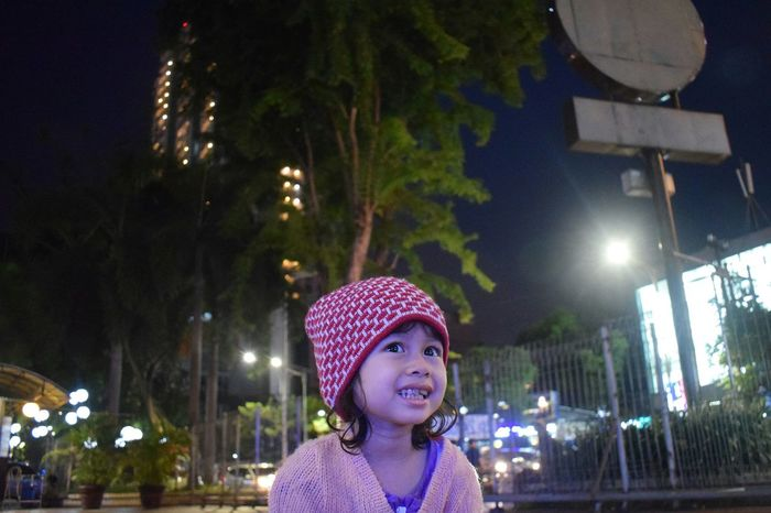 little girl and the city. EyeEmNewHere Surabaya Cityscape Streetphotography Streetlights Neon Neon Lights Night Lights Beautiful Asian  EyeEm Selects EyeEm Best Shots EyeEmBestPics Tumblr Child Warm Clothing Front View Knit Hat Outdoors Close-up One Person People