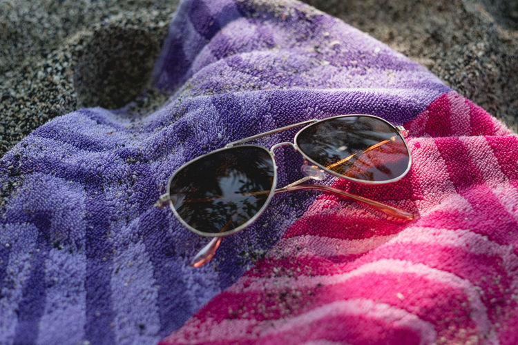 High angle view of sunglasses on water