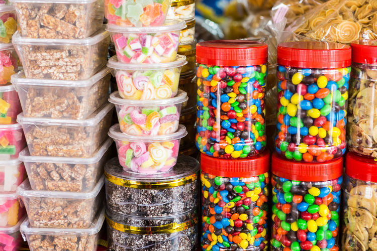 Stack on candies for sale in shop