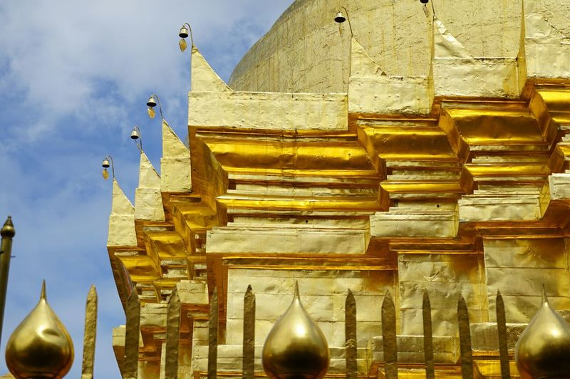 Buddha Buddhist Temple Thailand Bangkok Thailand. Temple Architecture EyeEm Selects Sony Lens Bird Sculpture Gold Statue Place Of Worship Gold Colored Religion Spirituality Pagoda Architecture Spiral Stairs