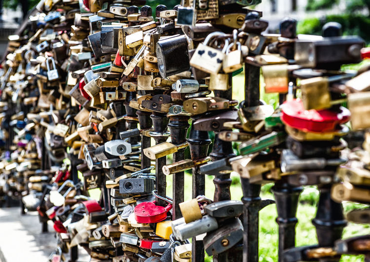 Different shapes, sizes and colors of love padlocks affixed to a bridge Iron Locks Love Objects Padlocks Romance Shape Wedding Bridge Bridge - Man Made Structure Close-up Concept Conceptual Large Group Of Objects Love Lock Many Marriage  No People Outdoors Padlocks Of Love Padlocks On Bridge Rusty Selective Focus Sweethearts Symbol