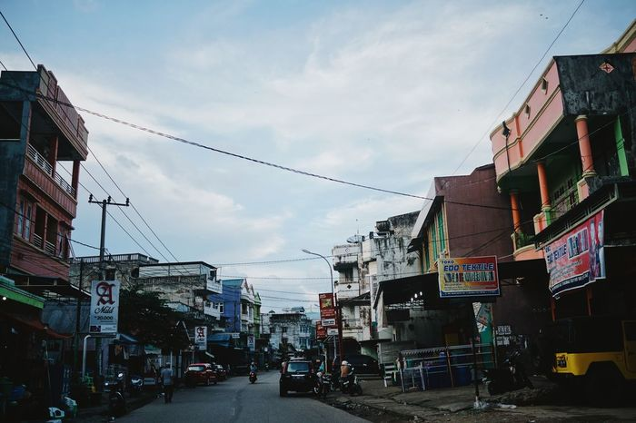 oh my Jogja Afternoon Light Architecture ASIA Asian Cities Asian Culture Asian Street Billboards Blue Sky Blue Sky And Clouds Building Exterior Built Structure Cable Cars City Colorful Buildings Day INDONESIA Residential Building Road Street Streetphotography Town Yogyakarta