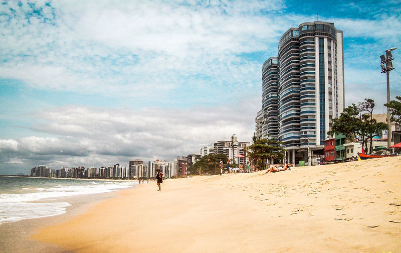 Beach Sea Sand City Incidental People Sky Architecture Building Exterior Built Structure Cloud - Sky #urbanana: The Urban Playground EyeEmNewHere Summer In The City