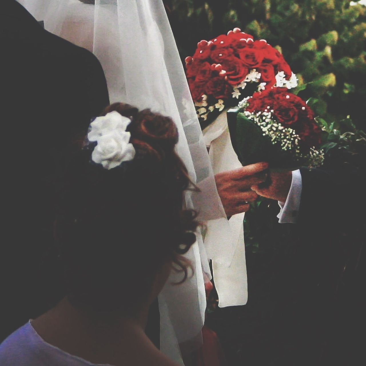Bride and bridegroom exchanging vows at wedding ceremony