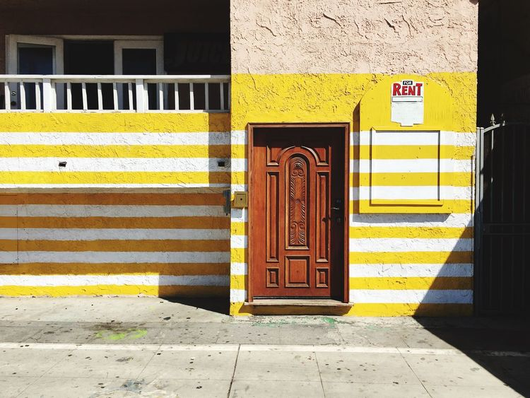 For Rent Stripes Beach House RENT Architecture Built Structure Yellow Door Entrance Building Exterior Day Text Communication Sign No People Sunlight Closed Outdoors Western Script City Building Striped