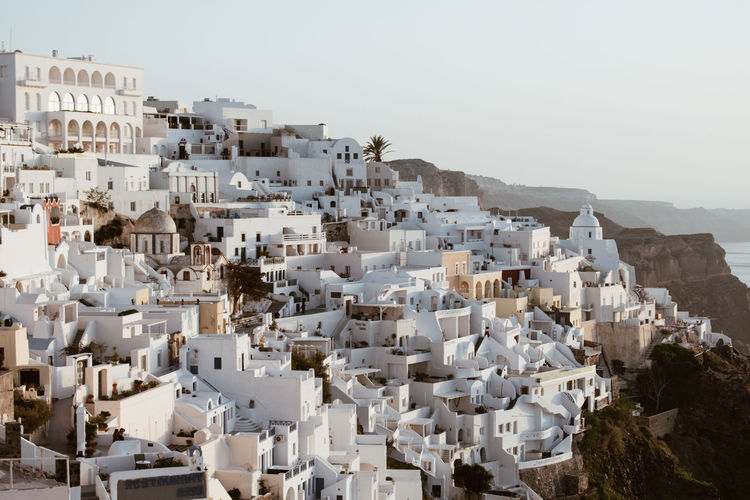 High angle view of buildings in city against clear sky. fira, santorini