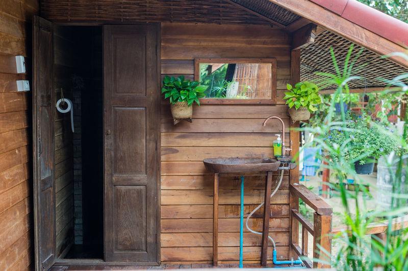 Potted plants on wooden door of building