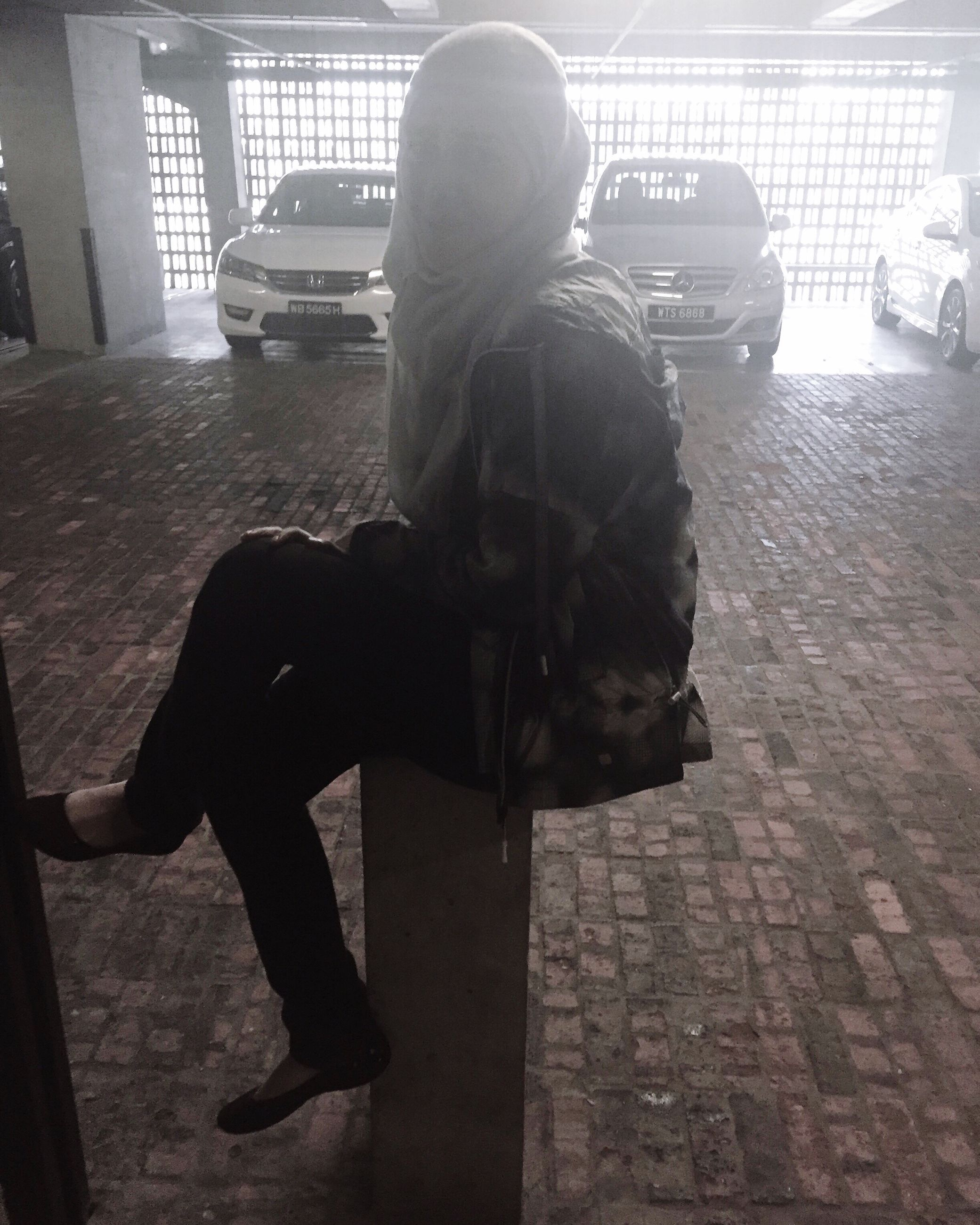 full length, indoors, lifestyles, sitting, men, casual clothing, leisure activity, side view, three quarter length, rear view, holding, pets, childhood, shadow, domestic animals, day, technology, sunlight