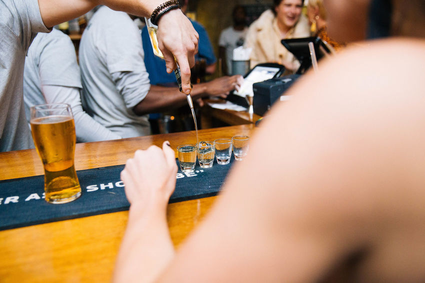 Adult Alcohol Arts Culture And Entertainment Beer Beer - Alcohol Drink Drinking Glass Entertainment Event Food And Drink Glass Group Of People Hand Human Body Part Human Hand Human Limb Men Midsection People Pint Glass Playing Refreshment Selective Focus Shots Women