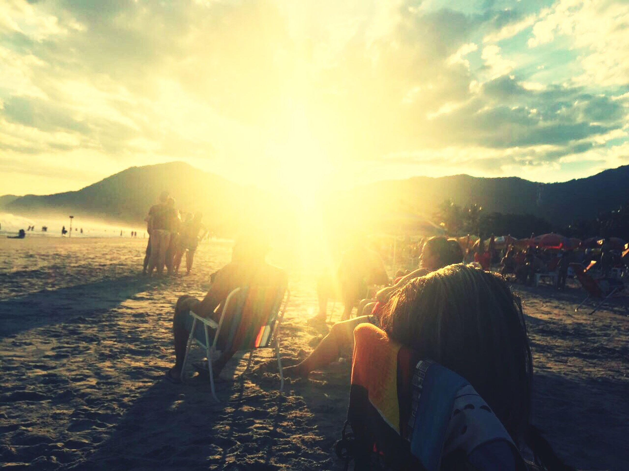 sun, sky, sunset, mountain, leisure activity, lifestyles, sunlight, sunbeam, beach, cloud - sky, person, scenics, lens flare, water, beauty in nature, nature, vacations, sitting