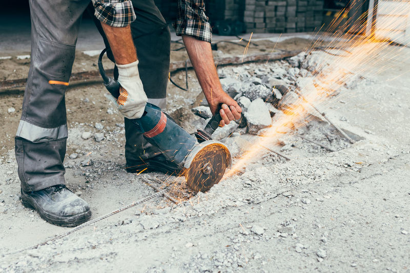 Low section of man working on fire