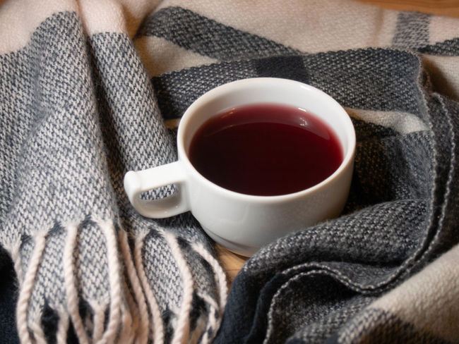 Cup Drink Mug Food And Drink Refreshment Hot Drink Indoors  Tea - Hot Drink Tea Close-up Tea Cup Textile Coffee - Drink Wool No People Black Tea Coffee Sweater Warm Clothing Freshness Crockery Jute Place Mat