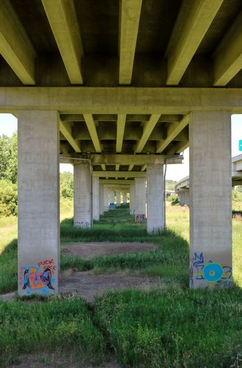 Architectural Column Architecture Below Bridge - Man Made Structure Built Structure Connection Day Engineering Graffiti Graffiti Art Graffiti Bridge Grass Nature No People Outdoors Transportation Under Underneath