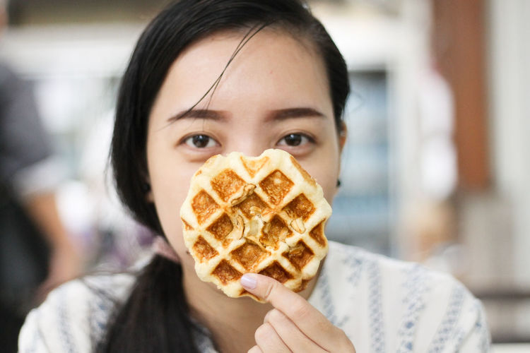Waffle time = happy time Sweet Food Snack Time Comfort Food Waffle Time The Week on EyeEm Human Hands Smiling Eyes Asian Eyes One Woman Portrait Women Young Women Headshot Looking At Camera Eating Winter Holding Happiness Waffle Moments Of Happiness