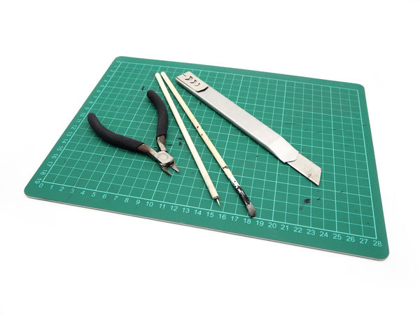 Tools with green cutting mat for model kit isolated on white background. Animal Close-up Colored Background Copy Space Cut Out Education Green Color Hand Tool High Angle View Indoors  No People Paper Shape Single Object Still Life Studio Shot Turquoise Colored Two Objects White Background White Color Work Tool
