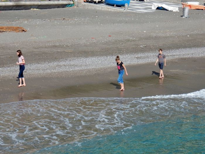Water Child Real People Beach Childhood Lifestyles Leisure Activity Sea Boys Males  Playing Family Togetherness Men Enjoyment Day Sport Full Length Land Positive Emotion Outdoors Amalfi Coast