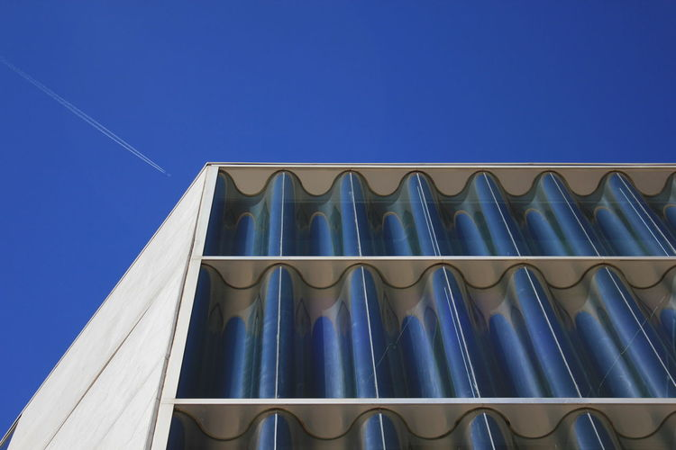 Casa da música Architecture Blue Building Exterior Built Structure Clear Sky Contrail Day Low Angle View No People Outdoors Sky Vapor Trail Window