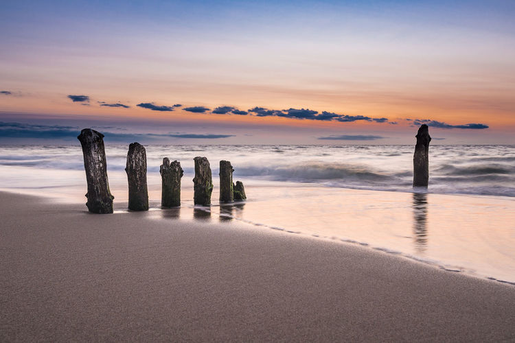Groynes on shore of the Baltic Sea. Baltic Sea Beach Beauty In Nature Bulb Coast Day Evening Groynes Holiday Kuehlungborn Landscape Long Exposure Nature Outdoors Scenics Sea Shore Sky Sunset Tourism Travel Destinations Vacation Water