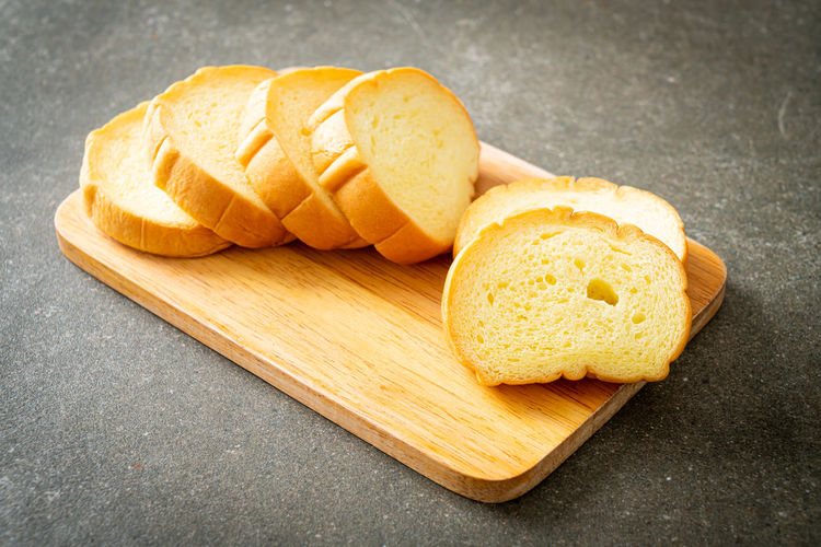 High angle view of yellow bread on cutting board