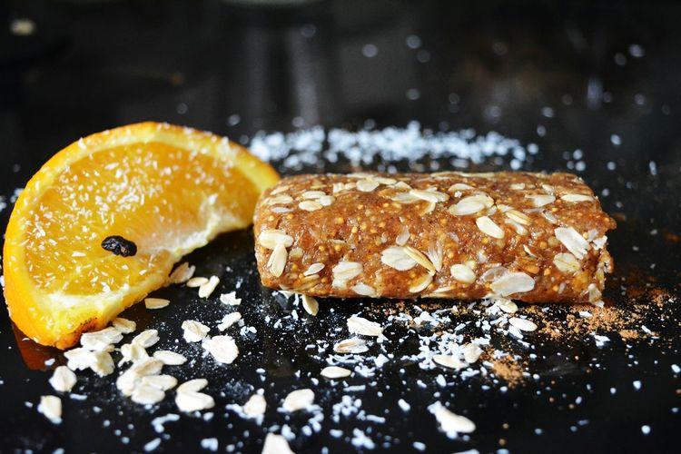 Close-up of orange slice with granola bar