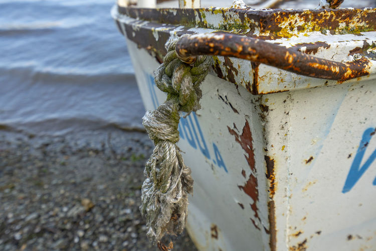 Close-up of rope tied on metal boat