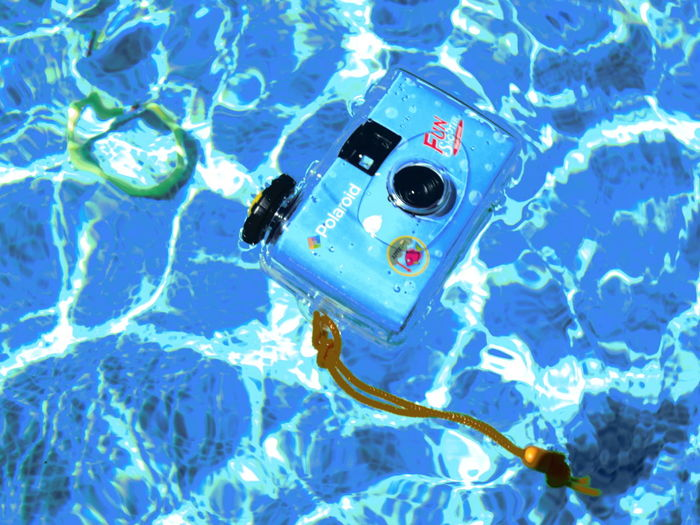 Blue Camera Floating On Water No People Poloroid Swimming Pool Water Water Surface