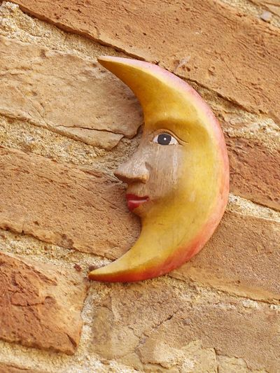 Italy🇮🇹 Toscana Decoration On Wall Outdoors Close-up Moon Moonsymbol Wood - Material Carvet In Wood Yellow Color Happy Face Fine Art Photography City Montepulciano Building Exterior Built Structure Brick Wall Brick Building LOOKING AT YOU !!!!!!!