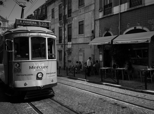 Black And White Friday Architecture Building Exterior Built Structure Outdoors Transportation Day Real People City People Tram Tramway Tram Cars Tram Tracks Lisbon Tram Lisbon Trams Street Photography EyeEmNewHere Black And White Photography Black & White Black And White Lisbon, Portugal Lisbon - Portugal Lisboa Lisbon tram Stories From The City Adventures In The City Modern Hospitality #urbanana: The Urban Playground