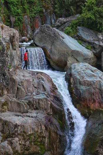Scenic view of waterfall amidst rocks