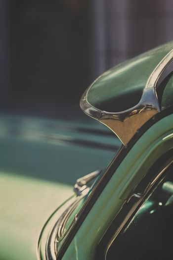 Close-up of cropped green vintage car