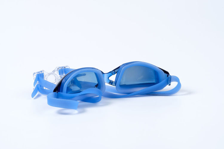 Blue Clean Equipment Glossy Goggle Goggles Rubber Swim Swimming Swimming Goggle White White Background Studio Shot Copy Space Still Life Indoors  Close-up No People Cut Out Single Object High Angle View Group Of Objects Reflection White Color Two Objects Table Protection Three Objects Plastic Personal Accessory Turquoise Colored