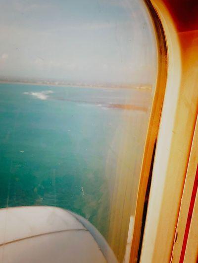 Airplane wing seen through window