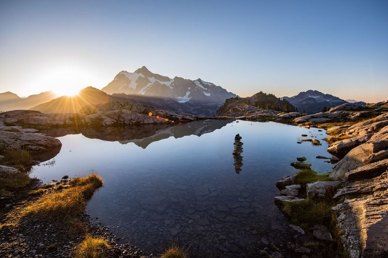 Mount Shuksan Mountain Clear Sky Sunbeam Sun Tranquil Scene Lake Water Scenics Sunlight Beauty In Nature Travel Destinations Tranquility Non-urban Scene Blue Mountain Range Idyllic Tourism Nature Lens Flare Bright Washington Mount Shuksan
